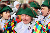 Participant greets visitors during annual carnival defile on central square in Nivelles — Stock Photo