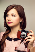 Young hipster woman make a photography with old camera — Stock Photo