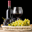 Winery still-life. Varieties of grapes with wineglass and bottle of white wine on black background — Stock Photo #52930317