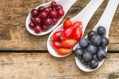 Fresh autumn berries on old wood table — Stock Photo