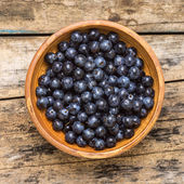 Top view of fresh wild berries on wood background — Stock Photo