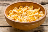 Clay bowl with dried corn flakes — Stock Photo