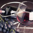 Glass of red wine with bottle and grapes — Stock Photo #57210019
