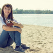 Young woman resting at the beach with old camera. — Stock Photo #57210109