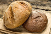 Two species of bread on paper bag — Stock Photo