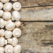 Mushrooms on wooden background. — Stock Photo #58264425