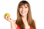 Young smiling girl holding green apple in hand. Fitness woman — Stock Photo