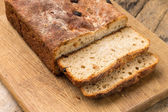 Sliced loaf of homemade unleavened wheat bread — Stock Photo