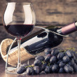 Winery background. Wineglass with bottle of red wine  — Stock Photo #67649321