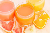 Fresh juice with different pieces of fruits. — Stock Photo