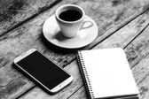 Black and white image of freelancer workspace. — Stock Photo