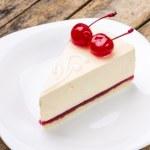 New York style cheesecake with pair of dessert cherries — Stock Photo #70812533