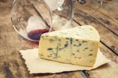 Blue cheese with wine glass — Stock Photo