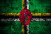 Grunge flag of Dominica with capital in Roseau — Stock Photo