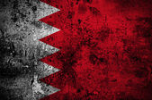 Grunge flag of Bahrain with capital in Manama — Stock Photo