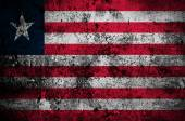 Grunge flag of Liberia with capital in Monrovia — Stock Photo