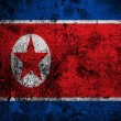 Grunge flag of North Korea with capital in Pyongyang  — Stockfoto #54745833
