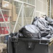 A lot of garbage in the street and container — Stock Photo #68897969