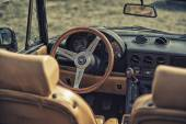 Sleza, Poland, August 15, 2015: Close up on Old Vintage steering wheel and cockpit of Apha Romeo on Motorclassic show on August 15, 2015 in the Poland — Stock Photo