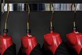Hanging men suits, closeup — Stock Photo