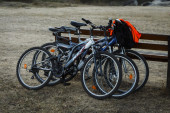 Parked bicycles near a bench — Stock Photo