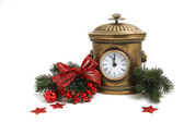 Old metal clock with Christmas decorations isolated on white — Stock Photo