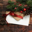 Christmas envelope with ribbon and decorations — Stock Photo #59349877