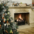 Christmas tree next to marble fireplace — Stock Photo #59742663