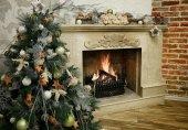 Christmas tree next to marble fireplace — Stock Photo