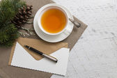 Cup of tea with blank empty paper sheet and Christmas decoration — 图库照片