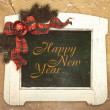 Happy new year sign framed in white colored vintage frame — Stock Photo #60464067