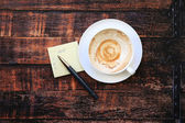 Empty coffee cup with plan list  — Stock Photo