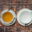 Full and empty cups of tea on old wooden table — Stock Photo #62050521