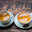 Two cups full of tea on old wooden table — Stock Photo #62050529