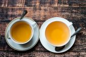 Two cups of tea on old wooden table — Stock Photo