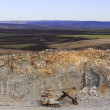 Quarry and old machine — Stock Photo #64339573