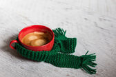 Cup of coffee with knitting — Stock Photo
