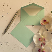 Letter envelopes with flowers — Stock Photo