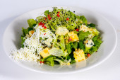 Fresh green salad with mixture of cheese — Stock Photo
