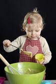 Little toddler making deserts — Stock Photo