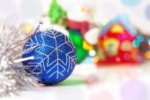 Blue Christmass ball with blury festive glitter lights backgroun — Stock Photo