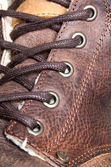 Autumn leather boot's lacing. — Stock Photo
