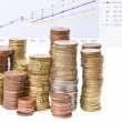 Coin stack and business chart over white — Stock Photo #67270977