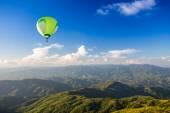 Hot air balloon over mountain — Stock Photo