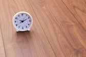 White clock on wood background — Stock fotografie
