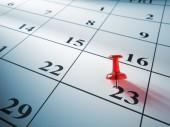 Red pin on calendar — Stock Photo