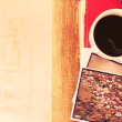 Top view of cup of coffe and stack of photos — Stock Photo #51840847