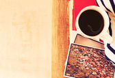 Top view of cup of coffe and stack of photos — Stock Photo