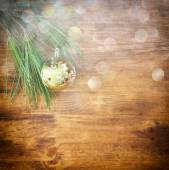 Christmas background with ornament, gift box and fir over table — Stock Photo