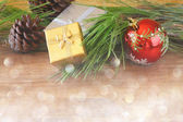 Christmas background with ornament, gift box and fir over table — Stockfoto